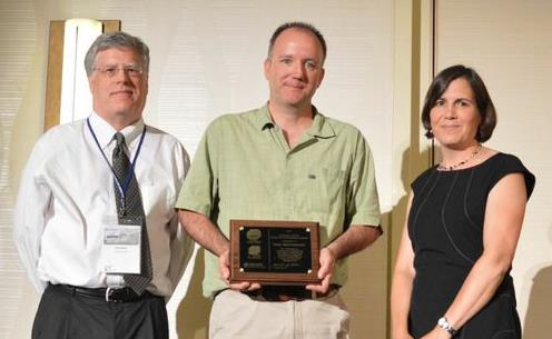 Paul Westerhoff of Arizona State University (center) accepts the ARCADIS/AEESP Frontier in Research Award from incoming president Jennifer Becker and awards committee chair Chad Jafvert