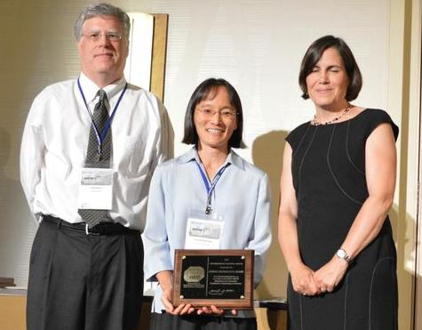 Junko Munakata Marr of the Colorado School of Mines accepts the Distinguished Service Award for Outstanding Service as a Co-Chair of the 2013 AEESP Research and Education Conference Organizing Committee