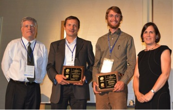 Greg LeFevre and Raymond Hozalski of the University of Minnesota (center right and center left, respectively) accept the Paul V. Roberts/AEESP Outstanding Doctoral Dissertation Award from incoming president Jennifer Becker and awards committee chair Chad Jafvert