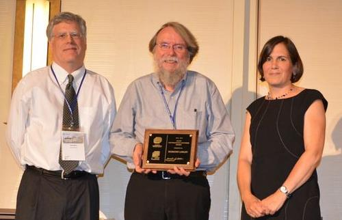 Desmond Lawler of the University of Texas (center) accepts the AEESP Distinguished Lecturer Award from incoming president Jennifer Becker and awards committee chair Chad Jafvert