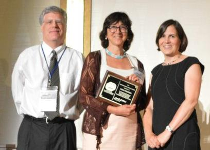Linda Figueroa of the Colorado School of Mines accepts the Distinguished Service Award for Outstanding Service as Chair of the 2013 AEESP Research and Education Conference Organizing Committee from incoming president Jennifer Becker and awards committee chair Chad Jafvert