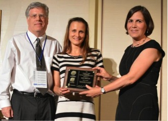Mari Winkler (middle) accepts the CH2M Hill Outstanding Doctoral Dissertation Award from incoming president Jennifer Becker and awards committee chair Chad Jafvert